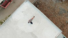 Girl dreamer lying on roof Stock Footage