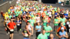 Blurred mass of marathon people runners Stock Footage