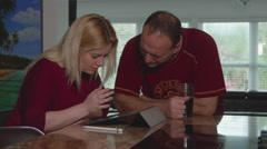 Woman Uses iPad Pro as Man Talks with Her - stock footage