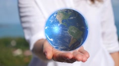 Holding Earth in Hand Stock Footage