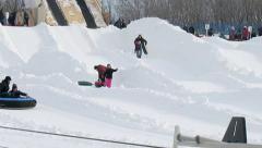 Children snowtubing in Montreal, Quebec, Canada. Stock Footage
