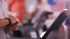 4K Woman working out on machine at the gym with personal fitness instructor Stock Footage