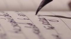 Hand Writing Ink Pen  in the Dark Room Stock Footage