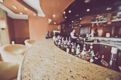 Blurred Bar with Bottle of Booze with Instagram Style Filter Stock Photos