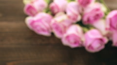 Pink roses on rustic wood table. Stock Footage