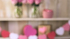 Pink roses in jars and gifts on rustic wood shelf for Valentines DAy. Stock Footage