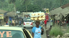 PAKRO STREET- BREAD SELLER AND WOMAN EXITING TAXI Stock Footage