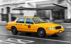 Yellow cab in Manhattan in a rainy day. Stock Photos