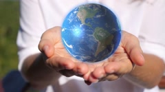 Earth in Female Hands Stock Footage