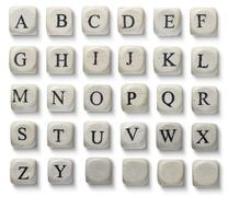 Alphabet letters on wooden pieces, isolated on white. - stock photo