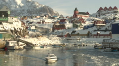 Still of a quiet little harbour and the town of Sisimiut in Greenland in winter Stock Footage