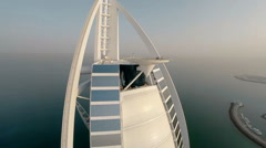Burj Al Arab hotel in Dubai, UAE. Helicopter view - stock footage