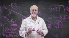 4K Scientist in white coat writing math formula on glass screen in front of came Stock Footage
