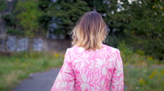 Model walking turning and looking in camera smiling Stock Footage