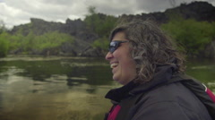 Stock Video Footage of Attractive female laughs as she white water rafts