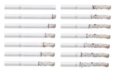 Cigarettes during different stages of burn. Isolated on white Stock Photos