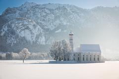St. Coloman with trees in wintery landscape, Alps, Germany Stock Photos
