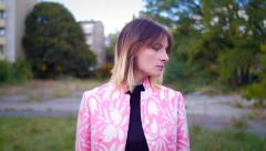 Model with pink dress posing and looking in camera Stock Footage