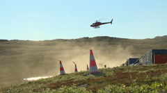 Helicopter leaving a mining site in Greenland Stock Footage