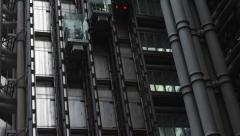 Close-up of elevators on the exterior of the Lloyds of London building Stock Footage