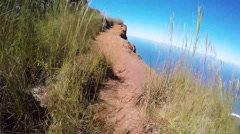 POV hike near cliff in Hawaii Stock Footage