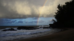 Sunset on beach, rainbow - stock footage
