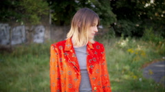 Model with red jacket posing and smiling in camera Stock Footage
