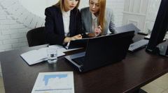 Everyday life in the modern office, two women at work - stock footage