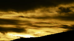 Golden clouds at sunrise in the mountain Stock Footage