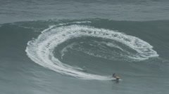 Big wave surfers ride huge waves - stock footage