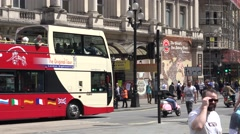 Stock Video Footage of 4K Traffic street central London city red bus pass motorbike festival motorcycle
