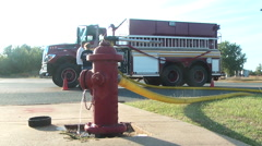 Fire truck with fire hydrant Stock Footage