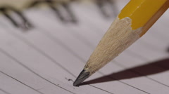 School Supplies - Lead Pencil on Lined Paper close up macro with negative space Stock Footage