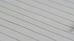 School Supplies - Lead Pencil on Lined Paper close up macro with negative space - stock footage