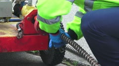 Sewer drain cleaning, adding sections to snake Stock Footage