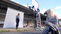 Open air fashion photo session slide - stock footage