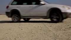 Manama Skyline from the desert a Car crossing the frame - stock footage