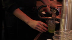 The barlady preparing a cocktail Stock Footage