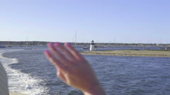 Young Woman Waves Goodbye To The Historic Nantucket Island In Massachusetts Stock Footage
