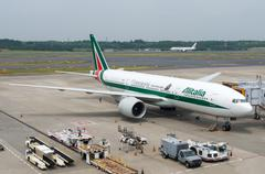 An Alitalia Plane on Airport Tarmac - stock photo