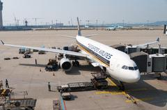 Singapore Airlines Plane on Airport Tarmac Stock Photos