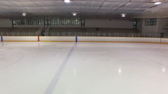 Dolly shot of Canadian Ice Rink interior - empty stands Stock Footage