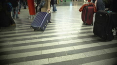 Many people walking with luggage, busy passengers at airport or railway station Stock Footage