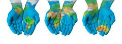 World map painted on hands isolated - stock photo