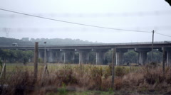 Highway bridge at dusk dawn, long shot, Portugal rural countryside Stock Footage