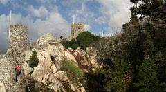 People climb down fortress walls, Castle of the Moors, Sintra, Portugal Stock Footage