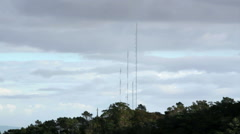 Radio tower antennas in mountain forest, long shot - stock footage