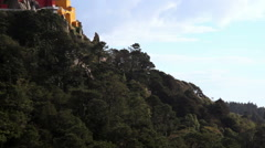 Pena National Palace, yellow red mountain castle, pan left tilt up, Sintra Stock Footage