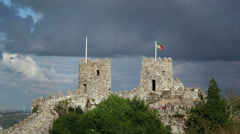 Watchtowers on fortress wall, Castle of the Moors, Sintra, Portugal flag Stock Footage