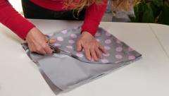 Dressmaker Cutting Clothes with Scissors Stock Footage